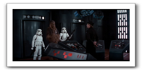 Luke, Han, and Chewie in front of the cell block commandant