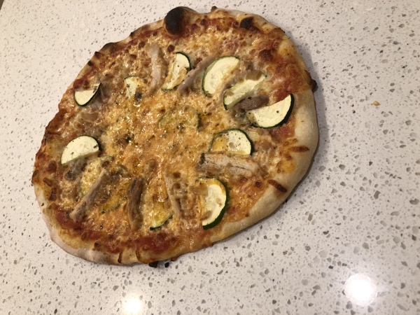 A pizza with chicken